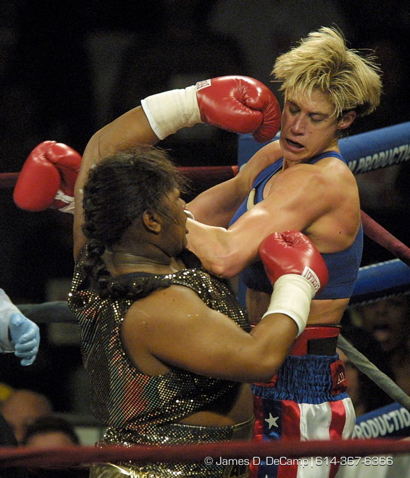 Vonda Ward, right, takes a licking from, and dishes it back out to, Kisha Snow, left, during the Third round of their heavyweight match Friday February 2, 2001 at the Ohio State Fairgrounds Celeste Center.  Ward won the match, making her the #1 female heavyweight in the country. (© James D. DeCamp 614-367-6366)