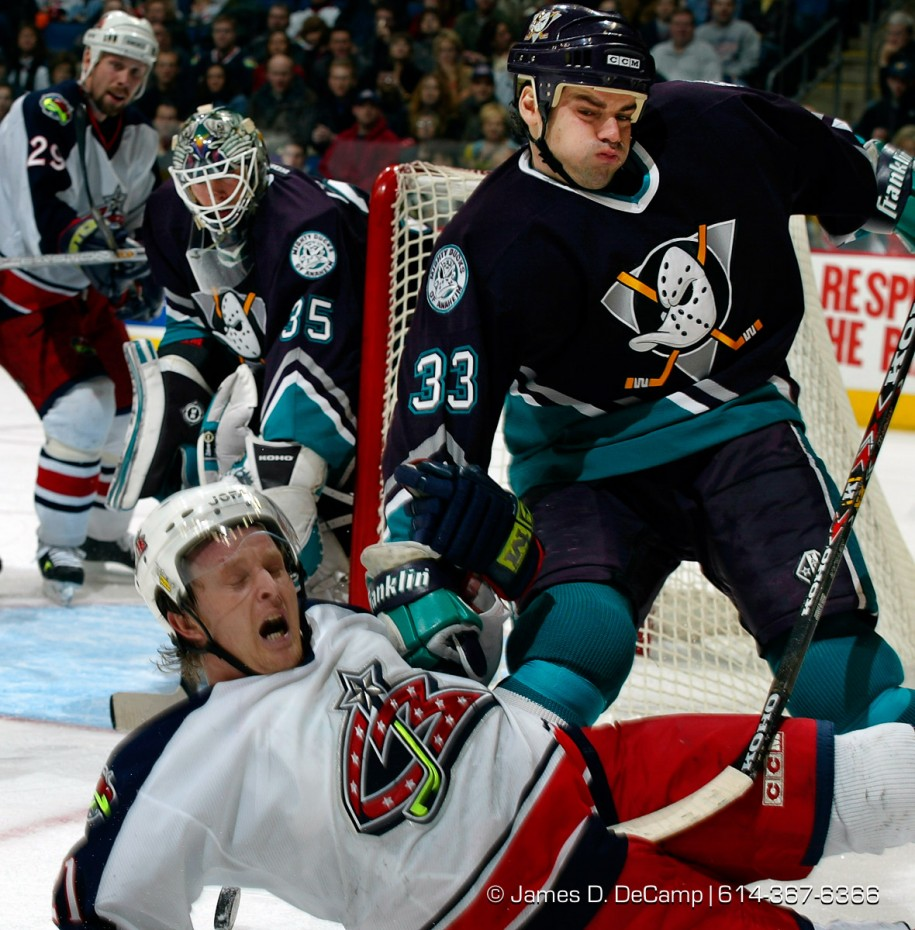 Anaheim Mighty Ducks #33 Jason York, right, swoops in and knocks down Columbus BlueJackets #21 Epsen Knutsen, bottom, in the third period of play at the Nationwide Arena December 31, 2001.  (© James D. DeCamp 614-367-6366)