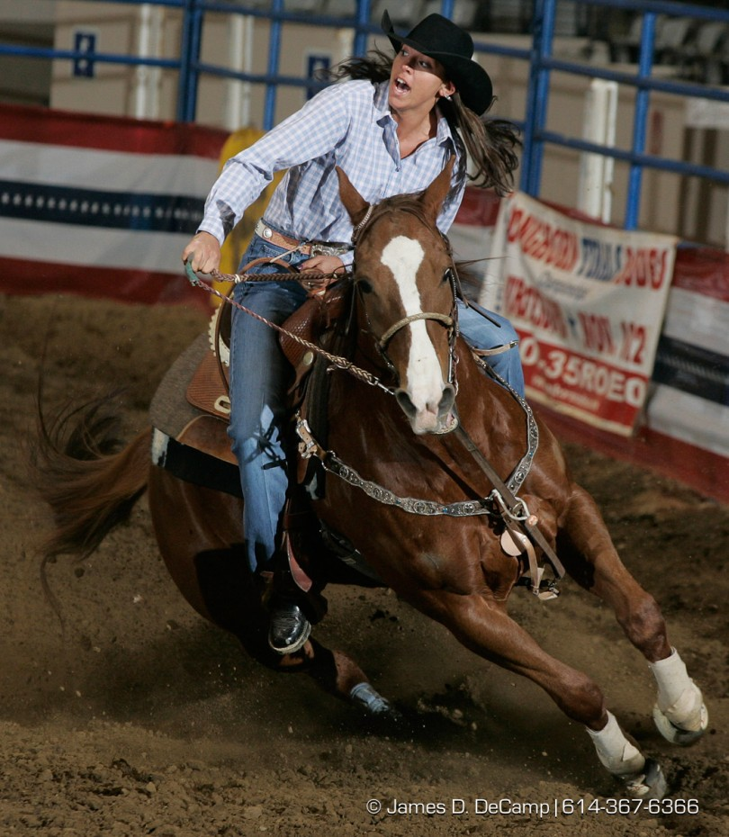 Ashley Bowers, Kewanee, IL, makes her way around the Cowgirls Barrel Racing course during Thursday February 3, 2005 Slack competition in the Longhorn World Championship Rodeo being held all weekend at the Ohio Expo Center. (© James D. DeCamp 614-367-6366)