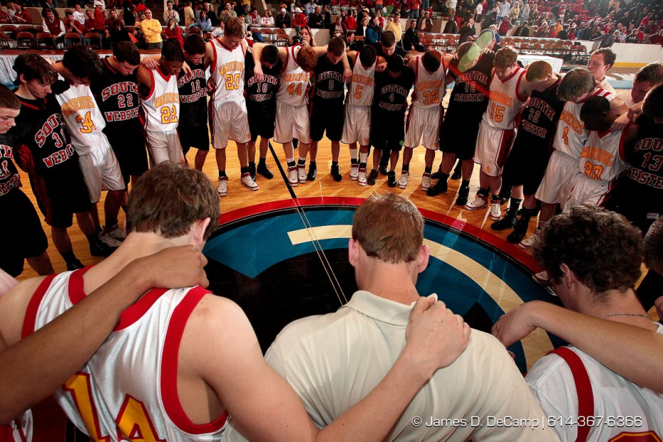 Worthington Christian High School and South Webster High School players pray together following South Websters win in the Ohio High School Athletic Association