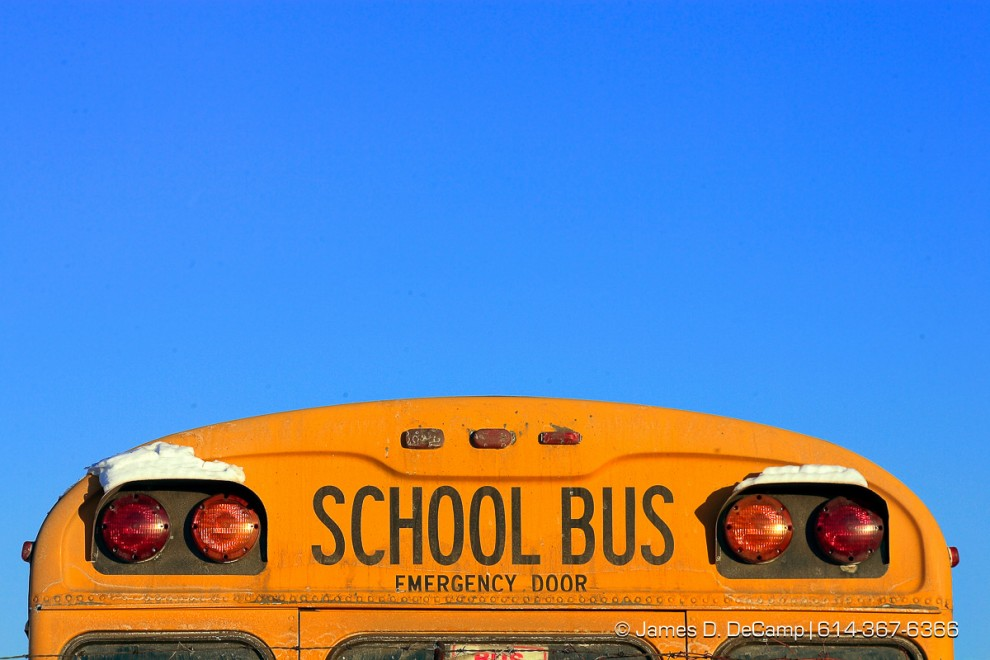 The top of the rear of a school bus displayed against a cloudless sky photographer Thursday afternoon February 8, 2007 at the Fort Hayes Bus Compound.  (© James D. DeCamp 614-367-6366)