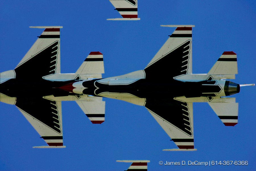 The Thunderbirds Aerobatic Team perform Friday afternoon September 28, 2007 during the 2007 gathering of Mustangs & Legends air-show going on at Rickenbacker ANGB all this weekend. (© James D. DeCamp 614-367-6366)