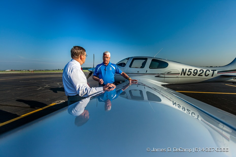John Gauch, Fleet Sales Director with Cirrus Aircraft, Blue Shirt, gives orientation information and flights to OSU College of Engineering Associate Dean Randy Moses, red tie, and other faculty Friday morning September 14, 2012 at OSU