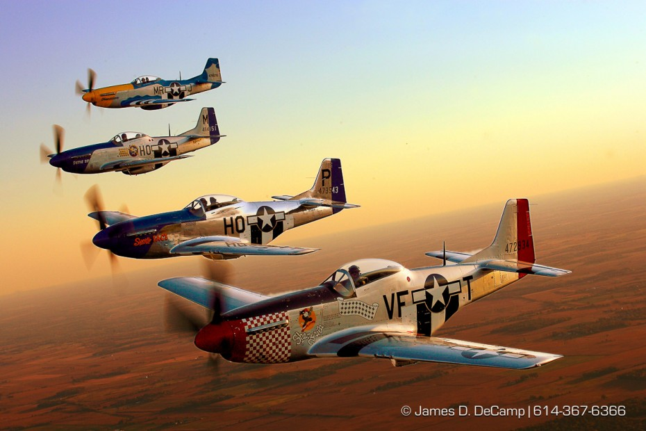 A formation of P-51 Mustangs flies next to my B-25 Mitchell bomber for a photo op over the skies of Pickaway county late Friday afternoon September 28, 2007 during the 2007 gathering of Mustangs & Legends air-show going on at Rickenbacker ANGB all this weekend.  (© James D. DeCamp 614-367-6366)