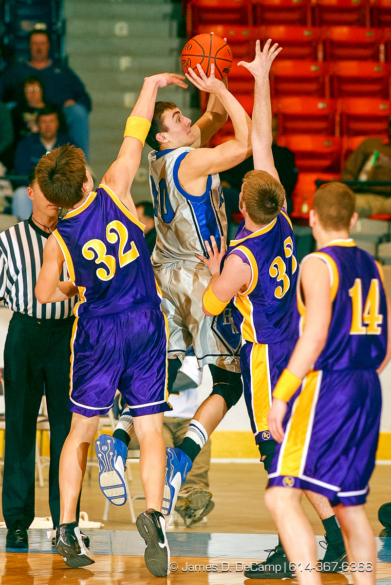 Bloom Carroll High School's #32 Kale Richardson, left, and #33 Ron Ball try to deflect a two pointer driven in by Bishop Ready High School's #10 Mackie McAndrew, center, in the second quarter of play of the Ohio High School Athletic Association's Division III Central District Boys Basketball Tournament held at the Ohio Expo Center and Fairgrounds Coliseum Thursday March 11, 2004. (© James D. DeCamp | http://www.JamesDeCamp.com | 614-367-6366) [Photographed with Canon D60 cameras in RAW mode with L series lenses]