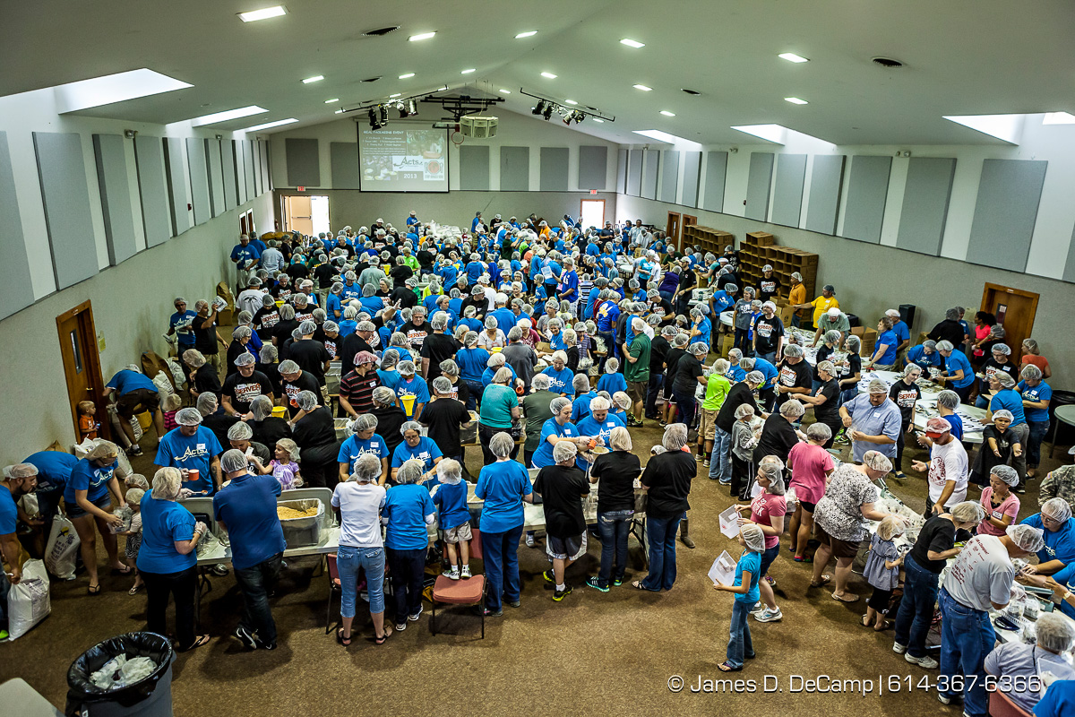 More than 350 volunteers pack an estimated 80,000 food bags at the Violet Baptist Church Sept. 29.  The food bags will be distributed by the Stop Hunger Now organization to more than 70 different countries around the world. (© James D. DeCamp | http://www.JamesDeCamp.com | 614-367-6366)