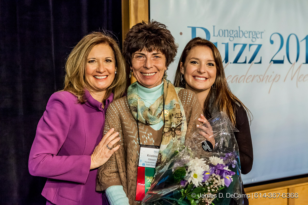 Longaberger President Tami Longaberger and her daughter Claire pose for a photo with on of the National Sales Leaders at the 2014 Longaberger Buzz photographed January 10, 2014. (© James D. DeCamp | http://www.JamesDeCamp.com | 614-367-6366)