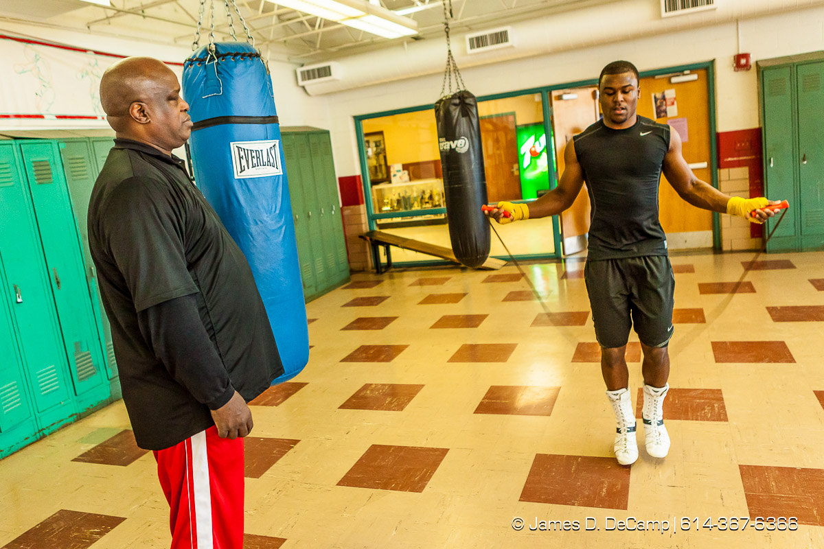 James 'Buster' Douglas and his son Artie photographed Tuesday January 6, 2015 at the Thompson Recreation Center. (© James D. DeCamp | http://www.JamesDeCamp.com | 614-367-6366)