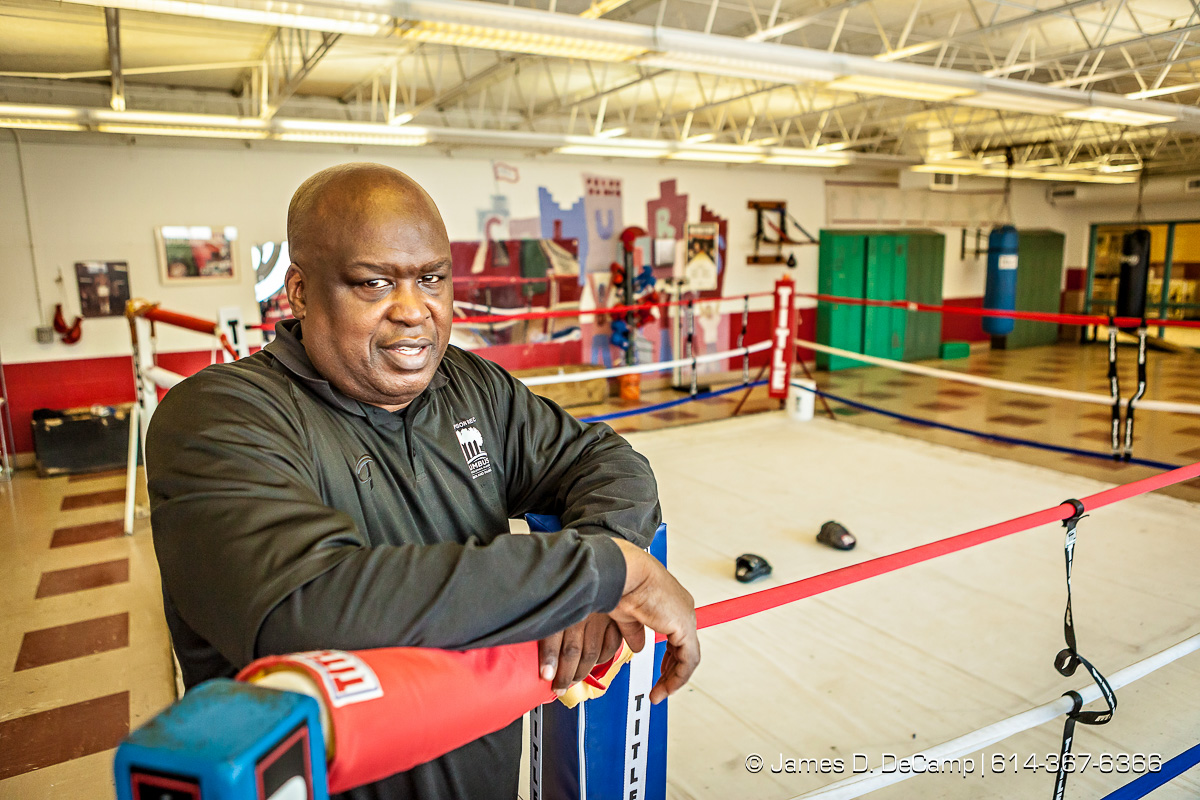 James 'Buster' Douglas and his son Artie photographed Tuesday January 6, 2015 at the Thompson Recreation Center. (© James D. DeCamp | http://www.JamesDeCamp.com | 614-367-6366) #Columbus #614 #Buster #heavyweight #JamesDeCamp #fighter