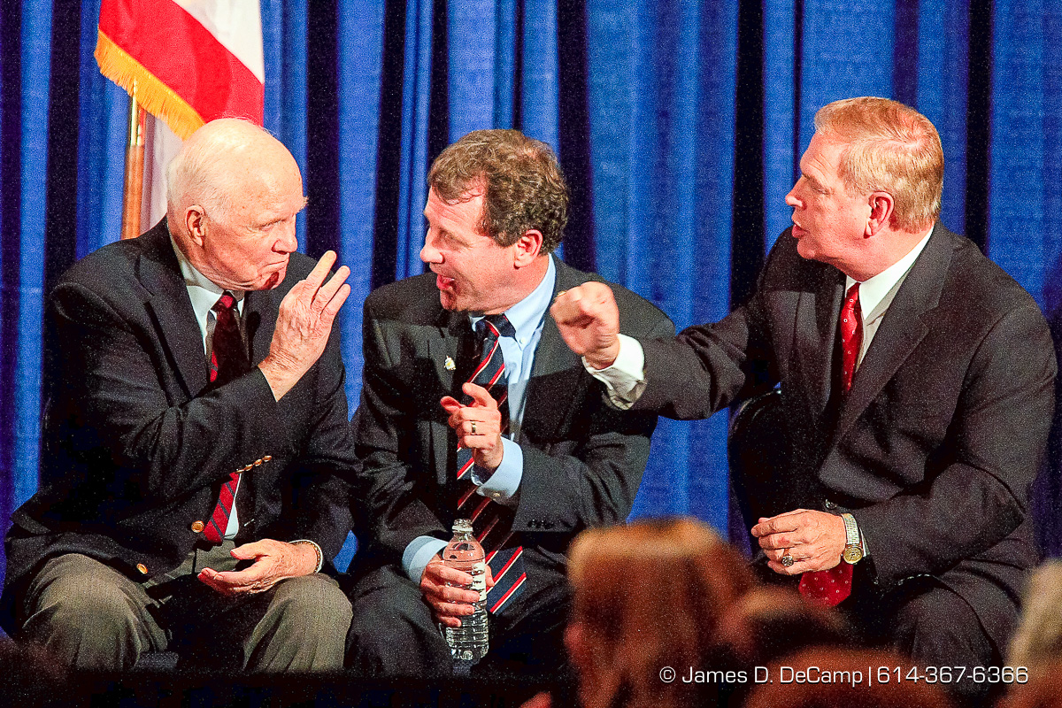 Senate Candidate Sherrod Brown, center, talks with former Senator and Astronaut John Glenn, left, and gubernatorial candidate Ted Strickland, during a speech given by Former President Bill Clinton at a Democratic fundraiser for Brown held at the Hyatt on Capitol Square Monday night October 23, 2006. (© James D. DeCamp   http://www.JamesDeCamp.com   614-367-6366) [Photographed with Canon 1D MkII cameras in RAW mode with L series lenses]