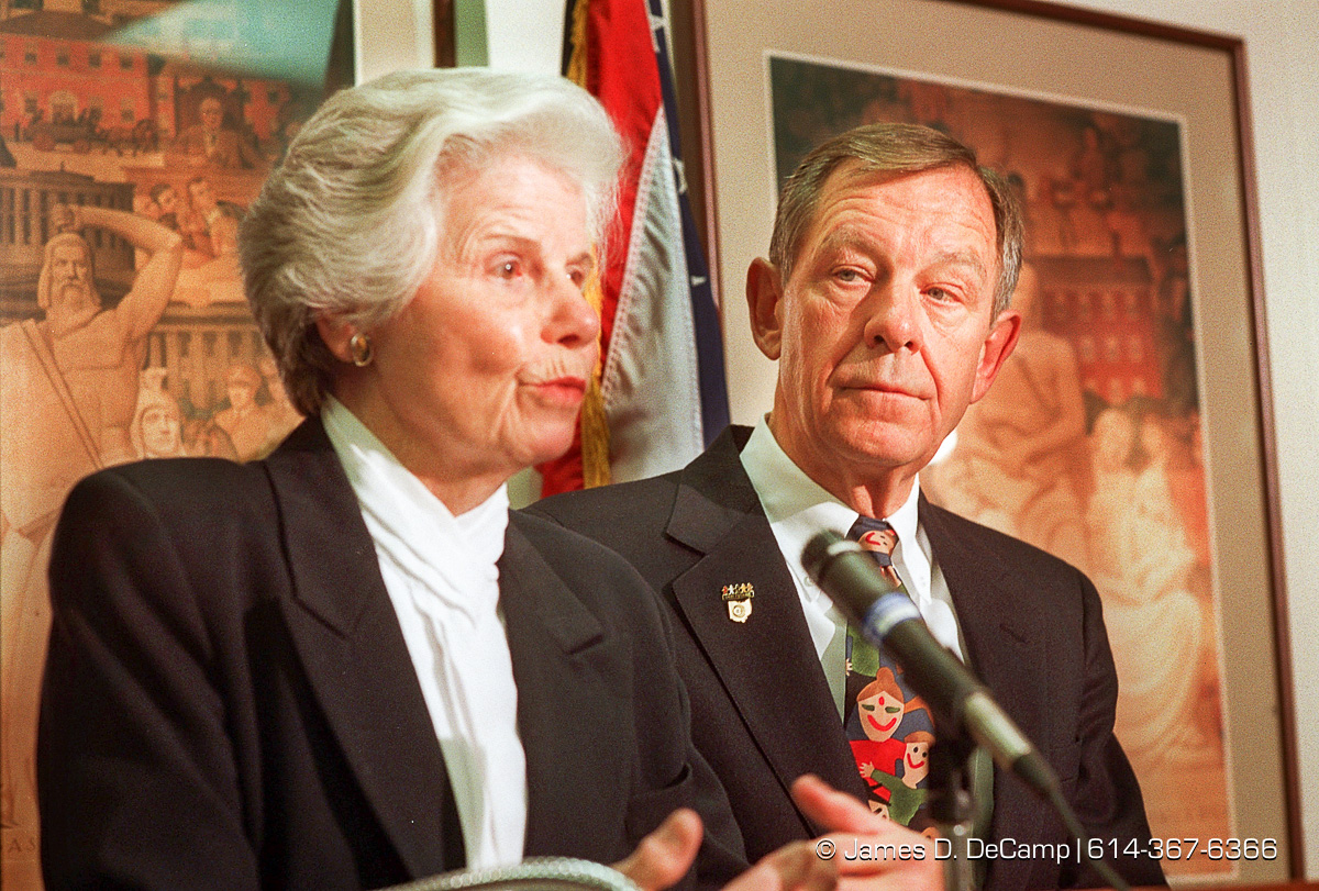 Govenor George Voinovich watches as speaker of the house Jo Ann Davidson talks about the defeat of state issue two at a conceding press conference in the Ohio Secretary of States office in the Rhodes Tower. (© James D. DeCamp | http://www.JamesDeCamp.com | 614-367-6366) [Photographed on Fuji film using Canon F-1 & T-90 cameras with L series lenses. Digitized with Kodak RFS 2035 plus film scanners]