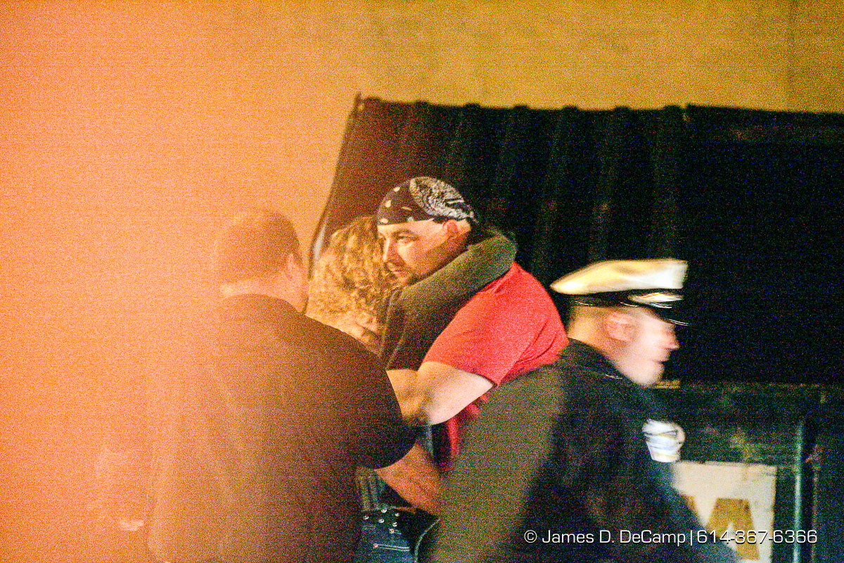 People hug in the parkinglot as Columbus, Worthington & Clinton Twp Medics work on one of seven shooting victims at the Alrosa Villa, 5055 Sinclair Road late Wednesday night December 8, 2004. (© James D. DeCamp | http://www.JamesDeCamp.com | 614-367-6366)