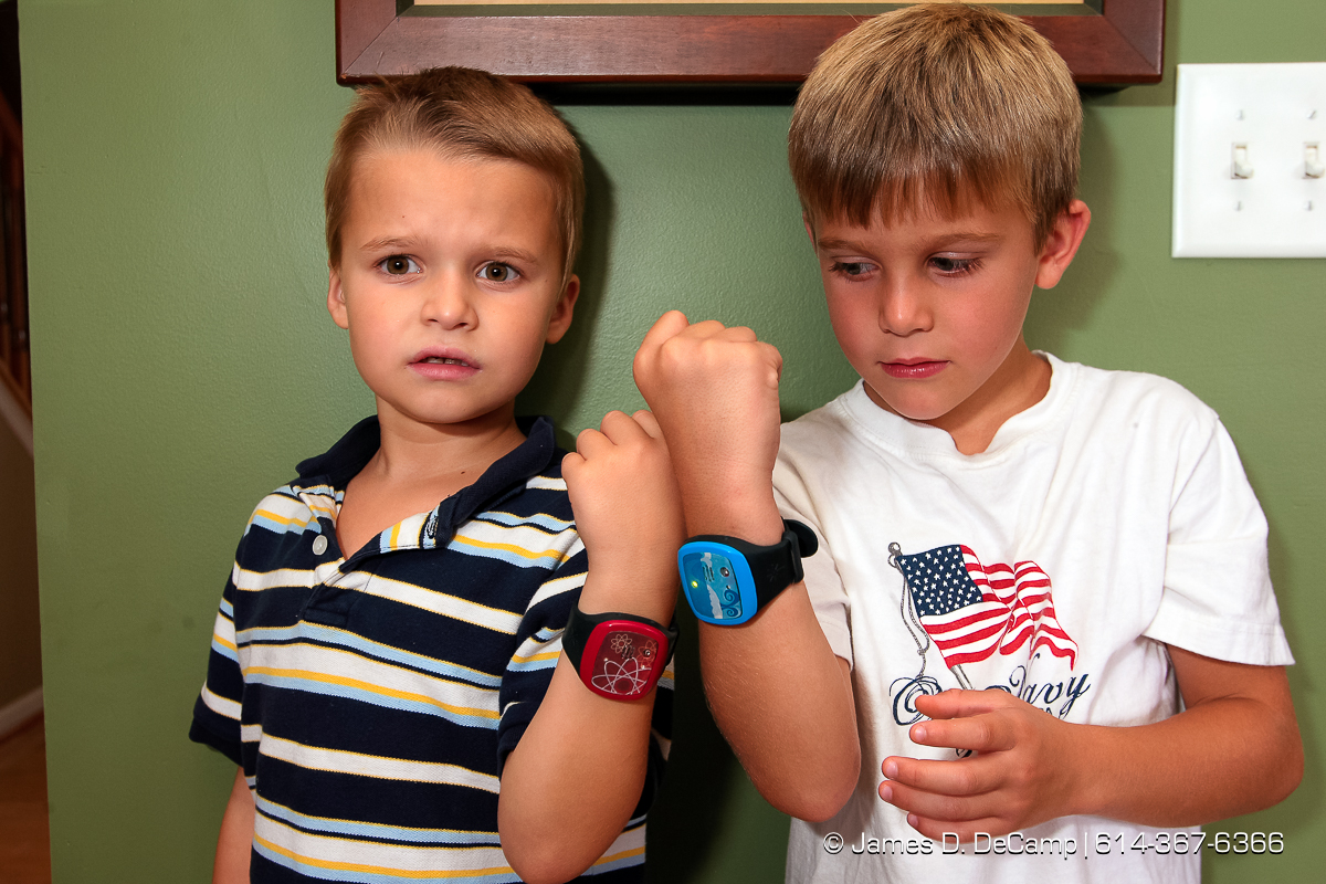 Alex Briner, 6, and Nate Kem, 6, show off their ionKids bracelets Wednesday August 15, 2007. The bracelet helps parents keep track of their active kids by activating an alarm, both on the bracelet and a parental control unit if the child strays too far. (© James D. DeCamp | http://www.JamesDeCamp.com | 614-367-6366) [Photographed with Canon 1D MkII cameras in RAW mode with L series lenses]
