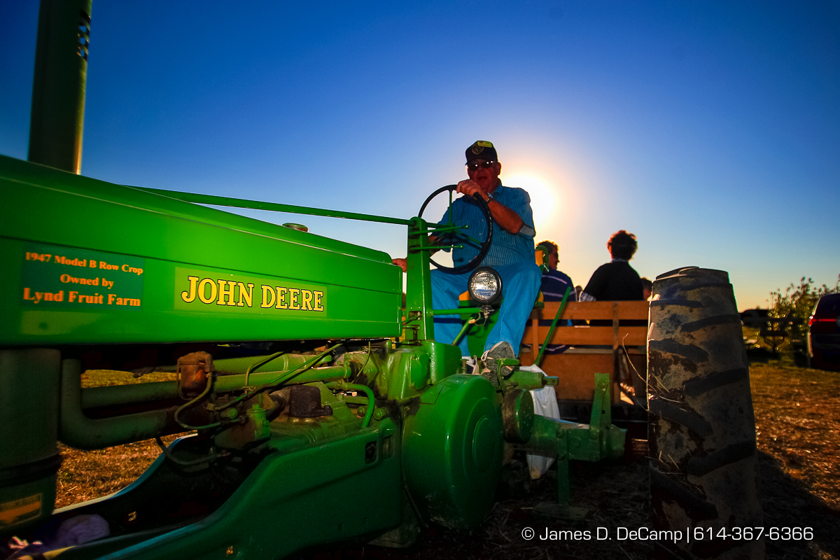 Ron Chapman, Tractor Driver, prepares to pilot his 1947 Model B John Deer Row Crop Tractor through the fields of Lynd's Fruit Farm in Licking County photographed Saturday October 20, 2007. (© James D. DeCamp | http://www.JamesDeCamp.com | 614-367-6366) [Photographed with Canon 1D MkII cameras in RAW mode with L series lenses]