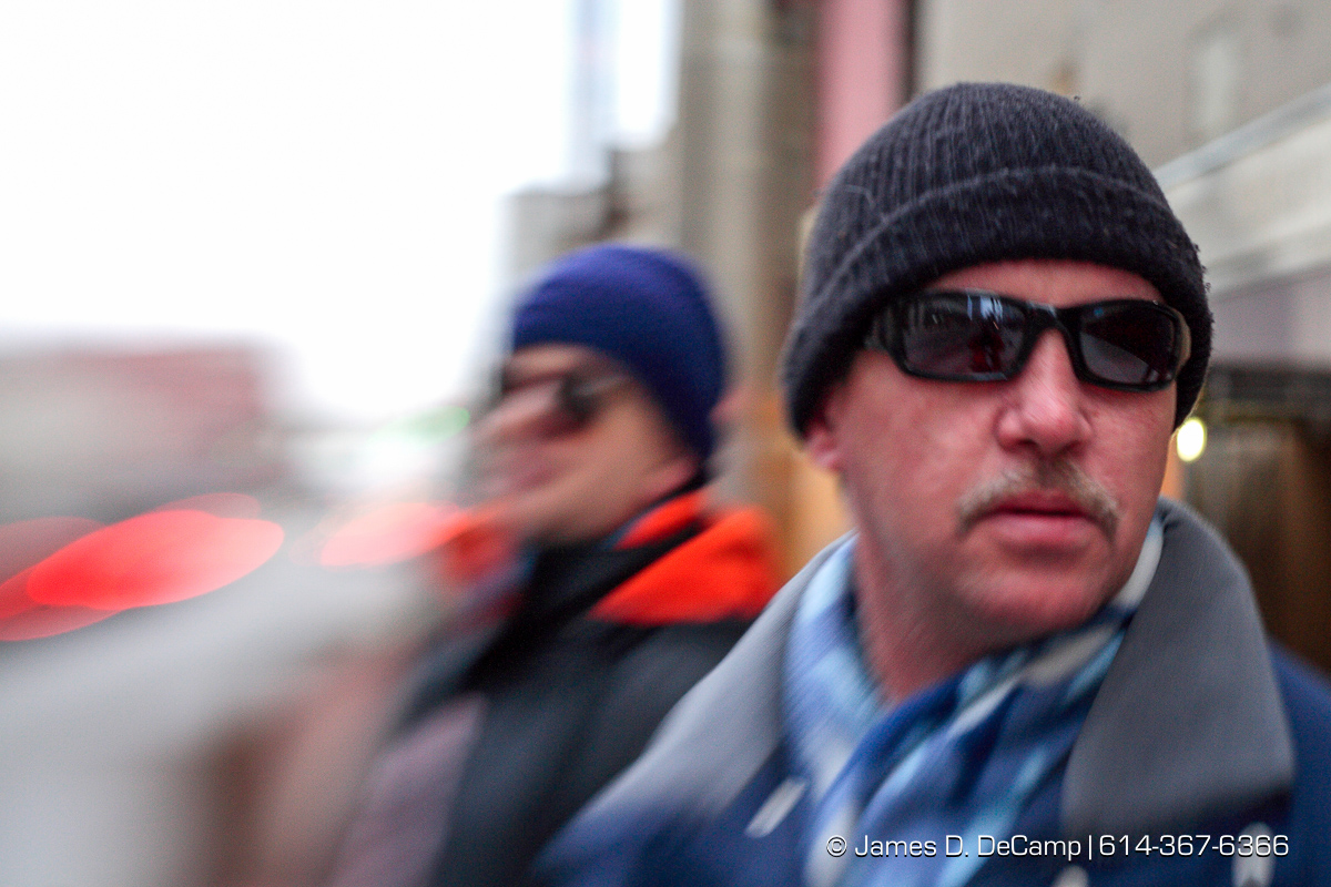 Randy Bailey during his downtown walk with his guide dog Brice Friday morning December 12, 2008. In the rear is classmate Kevin Dixon. The blur is created by the use of a special lens called a 'lens baby'. (© James D. DeCamp | http://www.JamesDeCamp.com | 614-367-6366) [Photographed with Canon 1D MkII cameras in RAW mode with L series lenses]
