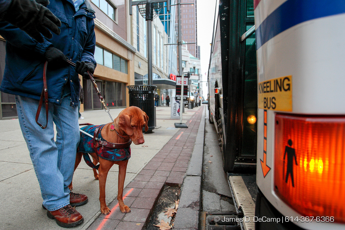 Randy Bailey during his downtown walk with his guide dog Brice Friday morning December 12, 2008. (© James D. DeCamp | http://www.JamesDeCamp.com | 614-367-6366) [Photographed with Canon 1D MkIII cameras in RAW mode with L series lenses]