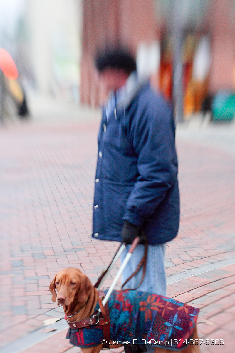 Randy Bailey during his downtown walk with his guide dog Brice Friday morning December 12, 2008. (© James D. DeCamp | http://www.JamesDeCamp.com | 614-367-6366) [Photographed with Canon 1D MkII cameras in RAW mode with L series lenses]