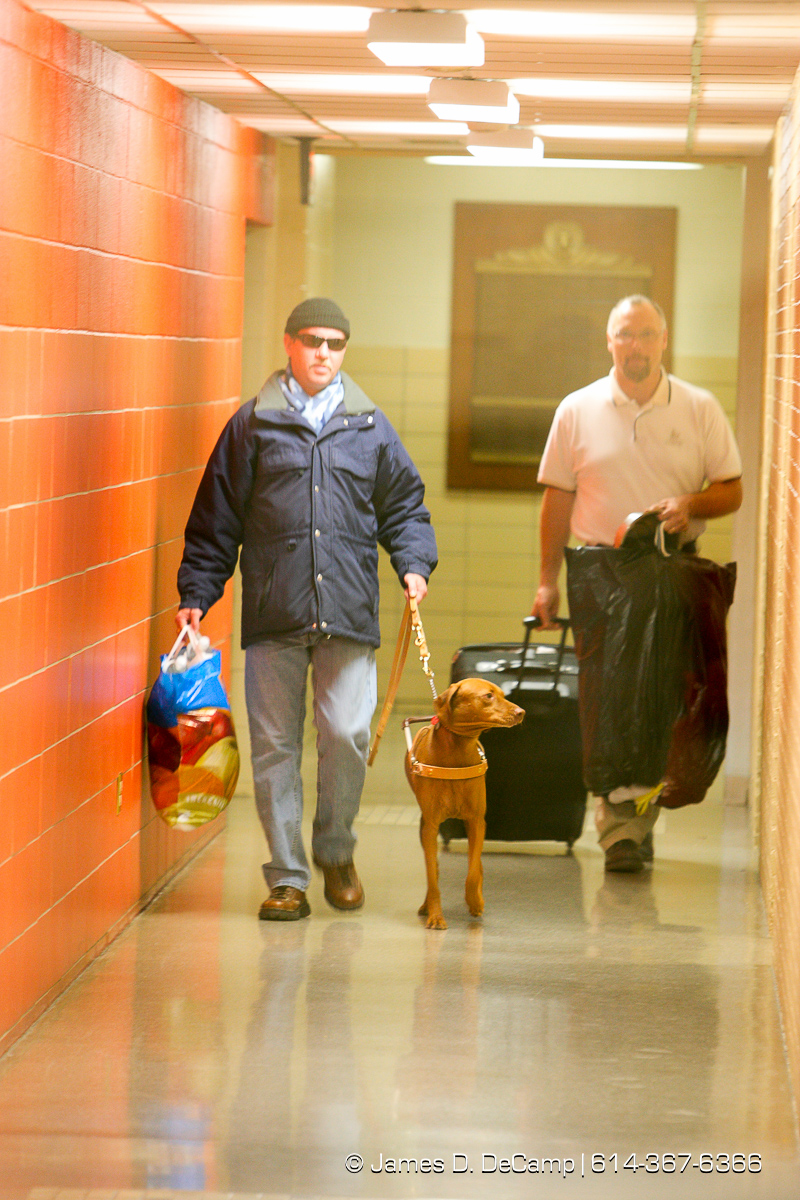 Randy Bailey, right, with his dog Brice makes his way down a hallway on his way home following successful training session at Pilot Dogs, Inc. On the right is Pilot Dogs, Inc Student Services Director Steve Hoyt (cq photographed Friday morning, December 19, 2008. (© James D. DeCamp | http://www.JamesDeCamp.com | 614-367-6366) [Photographed with Canon 1D MkIII cameras in RAW mode with L series lenses]