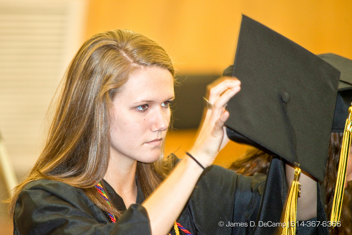 Nicole Lee Wagner adjusts her cap prior to the procession of graduates at the Upper Arlington High School Graduation Ceremony held Sunday afternoon June 6, 2010 at the Veterans Memorial Auditorium in Downtown Columbus. (© James D. DeCamp | http://JamesDeCamp.com | 614-367-6366)