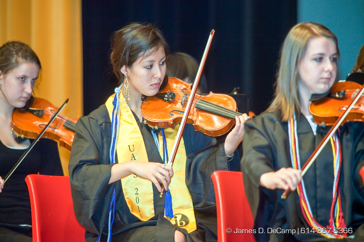 Jane Ting Tsai, with yellow, performs with the UAHS Symphony Orchestra at the Upper Arlington High School Graduation Ceremony held Sunday afternoon June 6, 2010 at the Veterans Memorial Auditorium in Downtown Columbus. (© James D. DeCamp | http://JamesDeCamp.com | 614-367-6366)