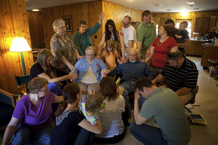 The Farrell / Kerlin / Wasie / Miller / DeCamp clans praying for Mom Farrell during their annual family get together at Ogelbay State Park. (© James D. DeCamp | http://www.JamesDeCamp.com | 614-367-6366)