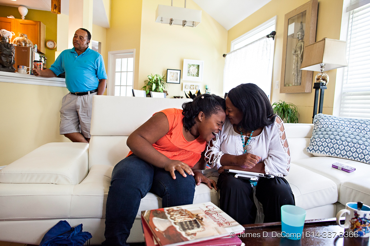 LaVerne and Terry Moore Jenkins photographed Monday August 8, 2016 with their adopted daughter Raychelle. (© James D. DeCamp | http://www.JamesDeCamp.com | 614-367-6366)