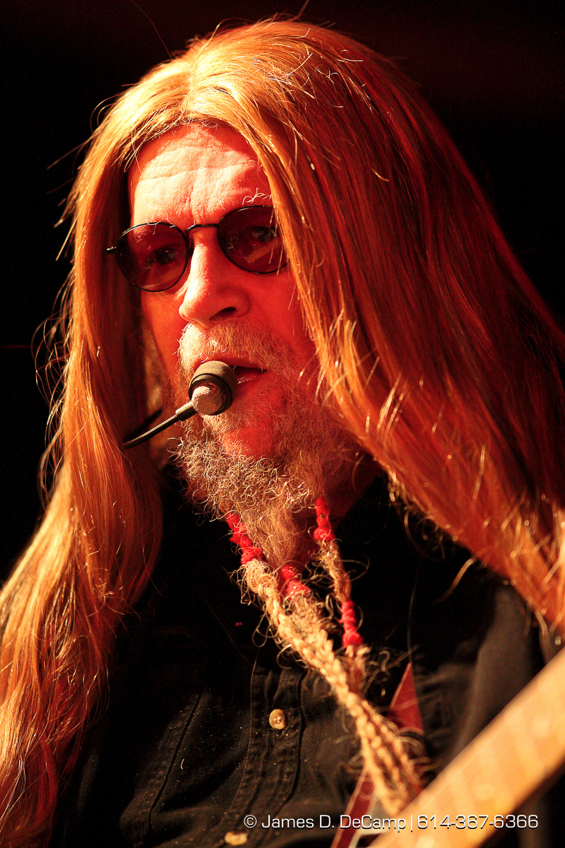 "David Allan Coe preforms at Screamin' Willie's in Columbus Ohio January 23, 2009. Coe is an American songwriter, outlaw country music singer, and guitarist who achieved popularity in the 1970s and 1980s As a singer, his biggest hits were ""Mona Lisa Lost Her Smile"", ""The Ride"", ""You Never Even Called Me by My Name"", ""She Used to Love Me a Lot"", and ""Longhaired Redneck"". His best-known compositions are the No. 1 successes ""Would You Lay With Me (In a Field of Stone)"" (which was covered by Tanya Tucker) and ""Take This Job and Shove It"" (which was later covered by Johnny Paycheck and inspired a hit movie; both Coe and Paycheck had minor parts in the film). (© James D. DeCamp 