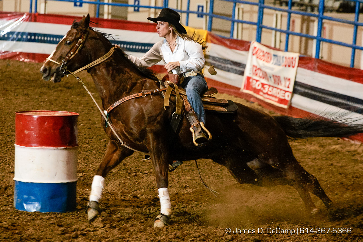 Amber Mostoller, Valley City, Ohio, makes her way around a barrel during Thursday February 3, 2005 Slack competition in the Longhorn World Championship Rodeo being held all weekend at the Ohio Expo Center. (© James D. DeCamp | http://www.JamesDeCamp.com | 614-367-6366) [Photographed with Canon 1D MkII cameras in RAW mode with L series lenses]