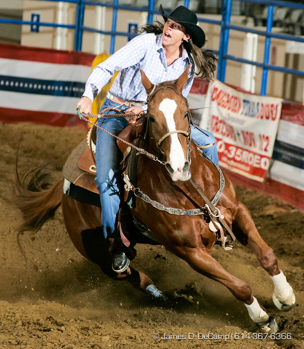 Ashley Bowers, Kewanee, IL, makes her way around the Cowgirls Barrel Racing course during Thursday February 3, 2005 Slack competition in the Longhorn World Championship Rodeo being held all weekend at the Ohio Expo Center. (© James D. DeCamp | http://www.JamesDeCamp.com | 614-367-6366) [Photographed with Canon 1D MkII cameras in RAW mode with L series lenses]