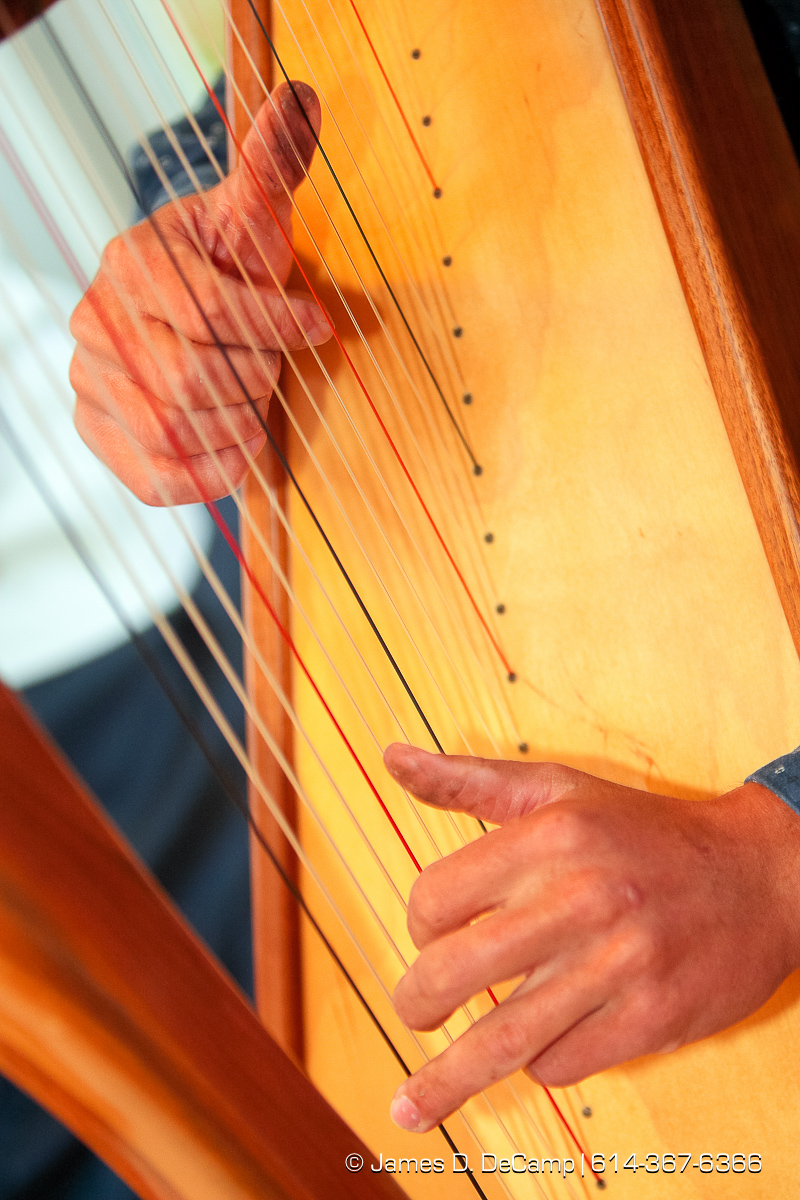 The hands of Joshua Hostetler on his harp photographed Wednesday evening October 1, 2008. (© James D. DeCamp | http://www.JamesDeCamp.com | 614-367-6366) [Photographed with Canon 1D MkIII cameras in RAW mode with L series lenses]