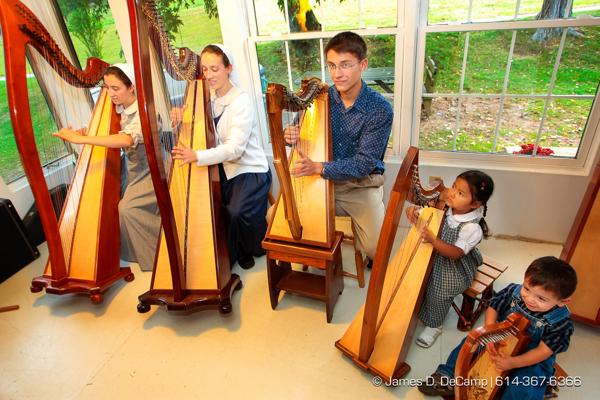 left to right - Daisy, 21, Darlene, 22, and Joshua, 18, Jewell, 3, and Jonathan, 2, Hostetler play Amazing Grace on their homemade harps photographed Wednesday evening October 1, 2008 at the Hostetler's home north of Coshocton. (© James D. DeCamp | http://www.JamesDeCamp.com | 614-367-6366) [Photographed with Canon 1D MkIII cameras in RAW mode with L series lenses]