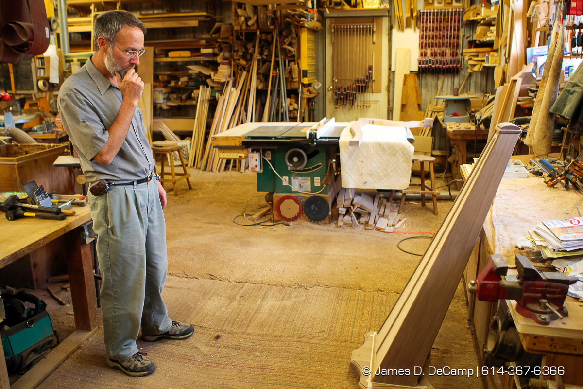 Reuben Hosteler inspects the sounding board of a Harp in progress photographed Wednesday evening October 1, 2008 at the Hostetler's workshop north of Coshocton. (© James D. DeCamp | http://www.JamesDeCamp.com | 614-367-6366) [Photographed with Canon 1D MkIII cameras in RAW mode with L series lenses]