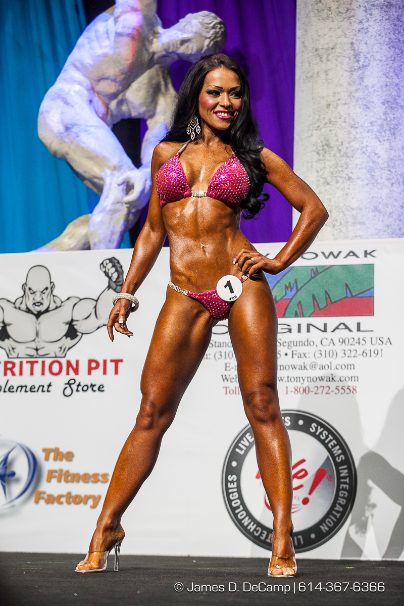 Overall Winners in the 2014 Arnold Amateur Men's Master, Classic, Body Building, Womens Fitness, Figure & Bikini Competitions photographed February 27, 2014 for BodyBuilding.com. (© James D. DeCamp | http://www.JamesDeCamp.com | 614-367-6366)