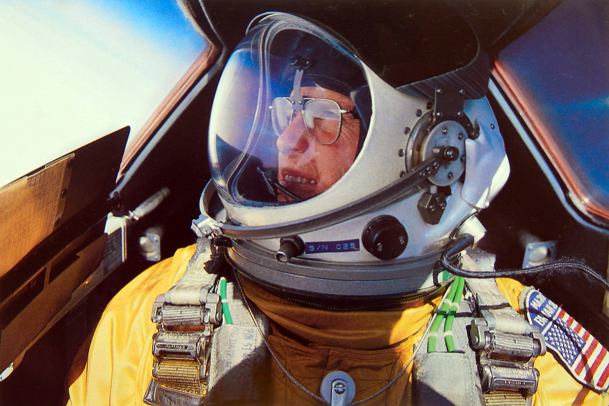 A self-portrait of Brian Shul in full flight suit gear within the cockpit of the SR-71 Blackbird.  Public domain photo courtesy of Wikipedia. (https://en.wikipedia.org/wiki/Brian_Shul)