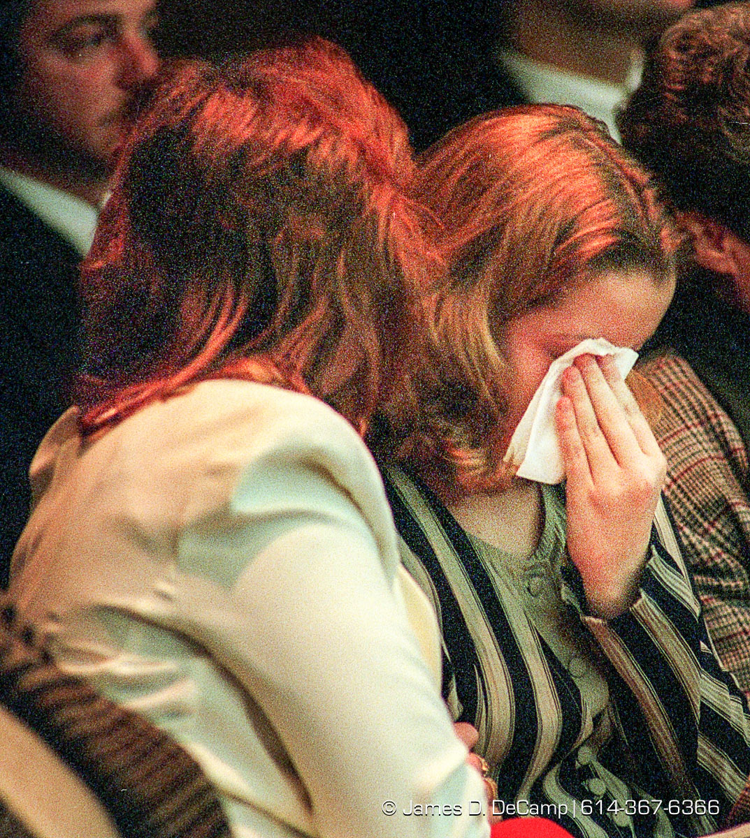 Kayla Dials, sister of the murder victim (Charles Dials, AKA Charlie Dials) that Defendant Alva Campbell supposedly killed, breaks down and is comforted by her mom Arlena Hughes, left, during opening statements as prosecuting attorney Ron O' Brien describes Campbell actions in Franklin County Common Pleas Courtroom 6D. (© James D. DeCamp | http://www.JamesDeCamp.com | 614-367-6366) [Photographed on Fuji film using Canon F-1 & T-90 cameras with L series lenses. Digitized with Kodak RFS 2035 plus film scanners]
