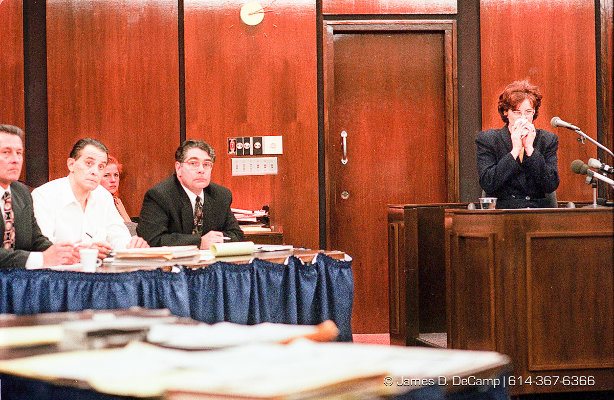 Defendant Alva Campbell sits flanked by his attorneys George Luther, left, and William Moon, right, as former Franklin County Sheriff Deputy Teresa Harrison recants of Campbell beat her and stole her service handgun last year. This was in Franklin County Common Pleas Courtroom 6D. (© James D. DeCamp | http://www.JamesDeCamp.com | 614-367-6366) [Photographed on Fuji film using Canon F-1 & T-90 cameras with L series lenses. Digitized with Kodak RFS 2035 plus film scanners]