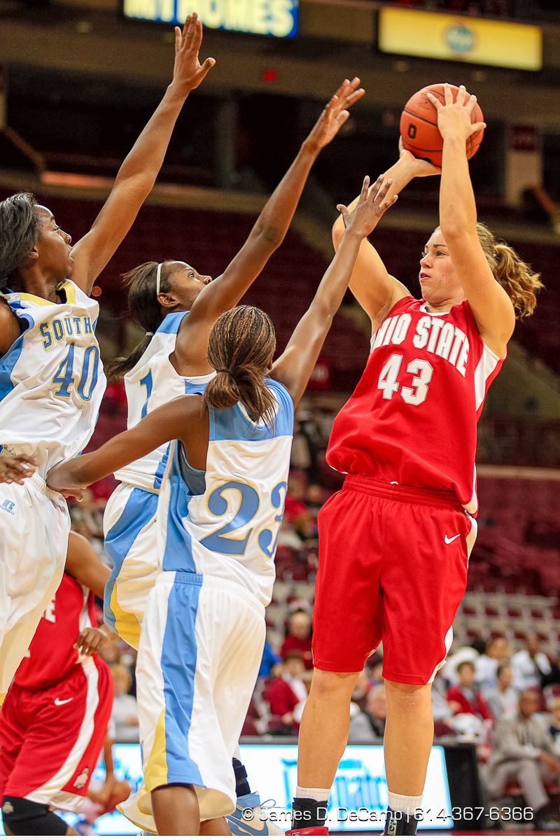 Ohio State University Buckeye's #43 Sarah Schulze shoots past the defense of the Southern University Jaguars at the Value City Arena Monday night November 19, 2007. from left, #40 Freda Allen, #1 Courtney Scott, and #23 Whitney Scott. (© James D. DeCamp | http://www.JamesDeCamp.com | 614-367-6366) [Photographed with Canon 1D MkII cameras in RAW mode with L series lenses]