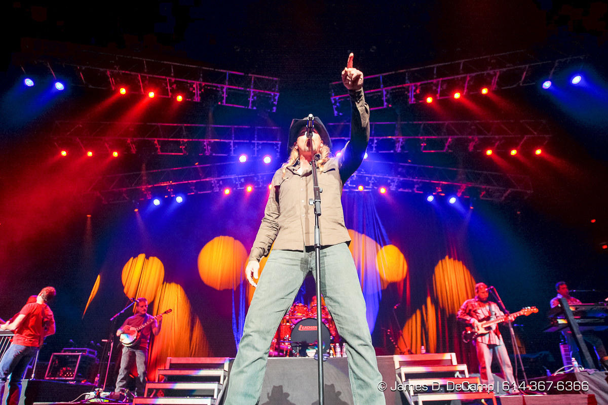 "Trace Adkins and Alan Jackson perform to a moderately large crowd gathered at the Jerome Schottenstein Center's Value City Arena Thursday night November 6, 2008. Alan Eugene Jackson is an American singer, songwriter and musician, known for blending traditional honky tonk and mainstream country sounds and penning many of his own hits. He has recorded 15 studio albums, 3 Greatest Hits albums, 2 Christmas albums, 2 Gospel albums and several compilations. Jackson has sold over 80 million records worldwide, with more than 50 of his singles having appeared on Billboard's list of the ""Top 30 Country Songs"". Tracy Darrell ""Trace"" Adkins is an American singer and actor. He made his debut in 1995 with the album Dreamin' Out Loud, released on Capitol Records Nashville. Since then, Adkins has released seven more studio albums and two Greatest Hits compilations. In addition, he has charted more than 20 singles on the Billboard country music charts, including the Number One hits ""(This Ain't) No Thinkin' Thing"", ""Ladies Love Country Boys"", and ""You're Gonna Miss This"", which peaked in 1997, 2007, and 2008, respectively. ""I Left Something Turned on at Home"" went to No. 1 on Canada's country chart. All but one of his studio albums have received gold or platinum certification in the United States; his highest-selling to date is 2005's Songs About Me, which has been certified 2? Multi-Platinum for shipping two million copies. Trace Adkins is widely known for his distinctive baritone singing voice. (© James D. DeCamp 