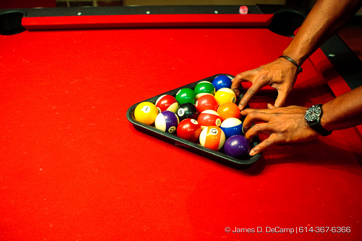 Jay Sule racks a set of balls on one of the pool tables at the Harrison's on Third bar Friday night November 7, 2008. (© James D. DeCamp | http://www.JamesDeCamp.com | 614-367-6366) [Photographed with Canon 1D MkIII cameras in RAW mode with L series lenses]