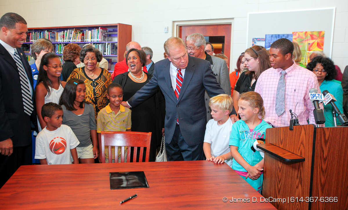 """Governor Ted Strickland holds a """"ceremonial"""" repeat signing of the $50.5 billion, two-year Ohio state budget at Thurgood Marshall High School in Dayton Friday July 17, 2009. The official signing apparently occurred about 3 p.m. at another location. A large gathering of Ohio Education Association members where on hand for the event. (© James D. DeCamp 