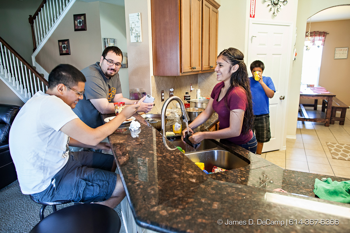Wilfredo and Dimarie Ocasio and their adopted family photographed Tuesday August 2, 2016 at the Killeen, Texas home. (© James D. DeCamp | http://www.JamesDeCamp.com | 614-367-6366)