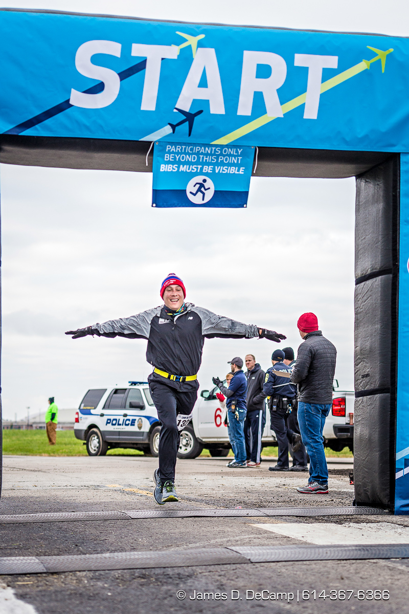 The John Glenn International Runway 5K Run & Walk photographed Sunday, October 29, 2017 at John Glenn Columbus International Airport. All proceeds were donated to Honor Flight Columbus, a nonprofit organization that provides senior veterans with a day in the nation's capital to visit the memorials built in their honor. (© Lexi Browning | http://JamesDeCamp.com | 614-367-6366)