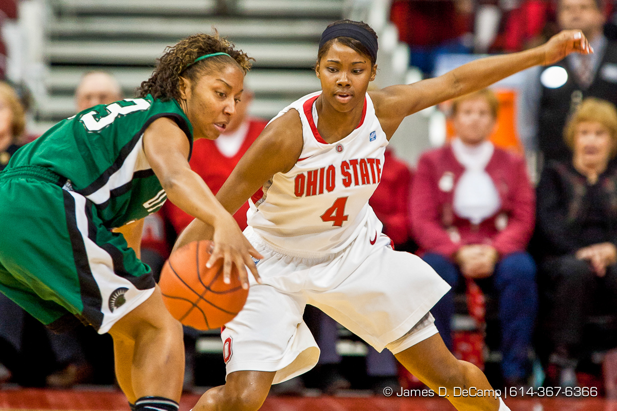 Ohio State University's Sophomore Guard Tayler Hill (#4) and University of South Carolina - Upstate's Sophomore Guard Tee'Ara Copney (#23) in the first period of play at the Value City Arena at The Jerome Schottenstein Center in Columbus, Ohio Tuesday evening December 14, 2010. The Buckeyes defeated the Lady Spartans 87-55 in the two teams first ever pairing. (© James D. DeCamp | http://www.JamesDeCamp.com | 614-367-6366) [Originally photographed for SouthCreek Global Media which went out of business in 2012. All sales requests should be directed to ZumaPress.com.]
