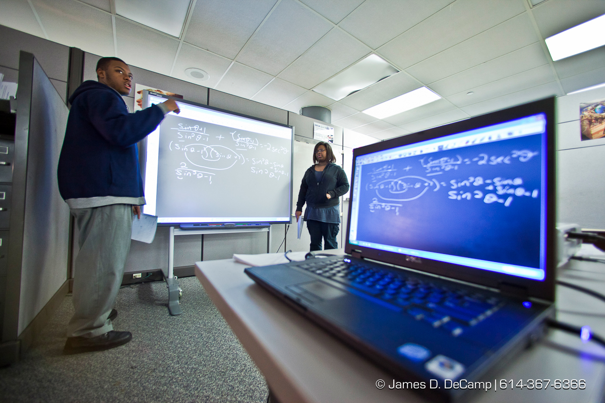 Ariel Phoenix, right, and Payne Jackson use a 'magic board' to show the class some math problems at the Dayton Early College Academy Wednesday December 15, 2010. (© James D. DeCamp   http://www.JamesDeCamp.com   614-367-6366)