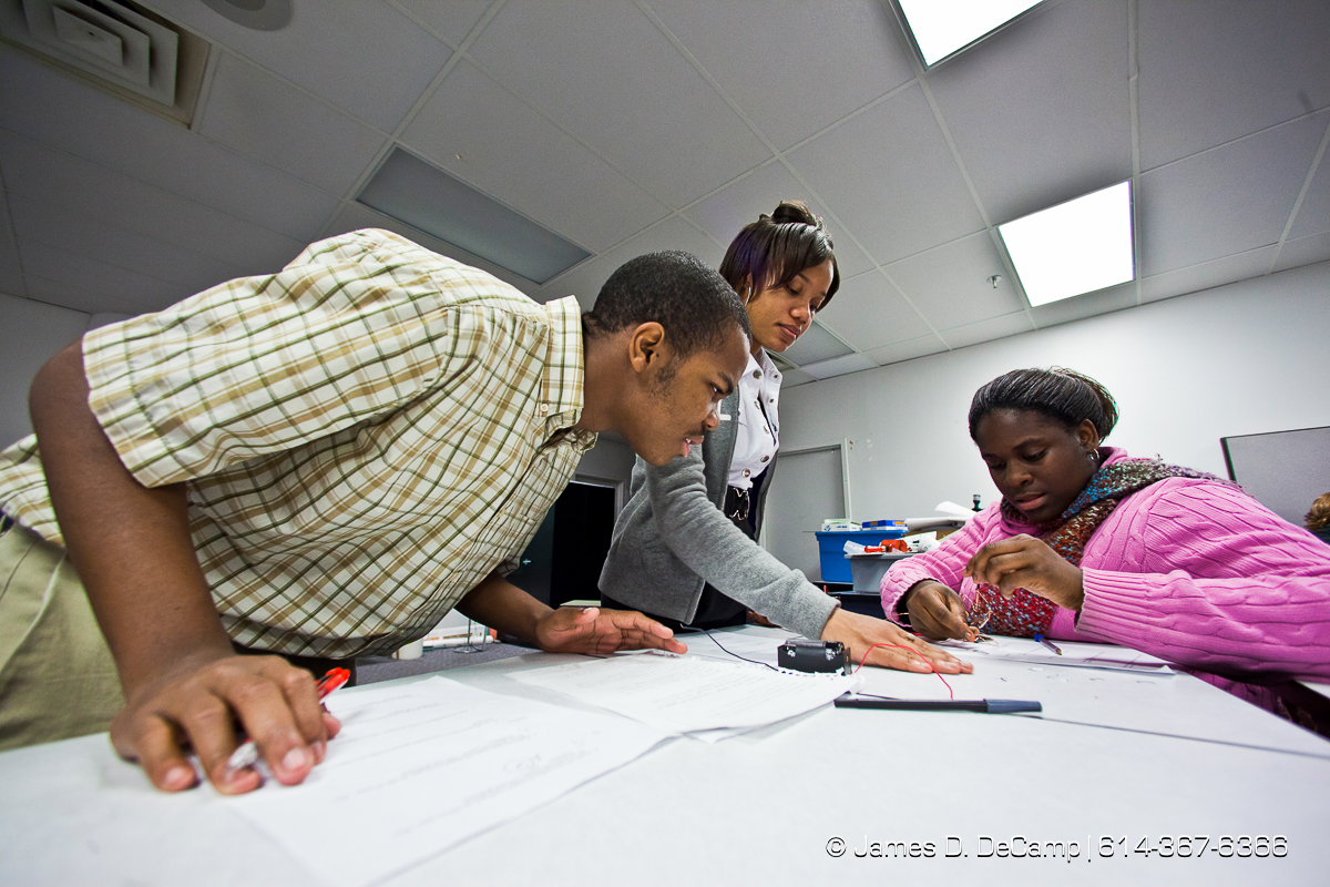 (l-r) Larry Vaughn, Jearra Bronaugh and Jalene Smith work on a magnetism project with batteries and coils in the science room of the Dayton Early College Academy Wednesday December 15, 2010. (© James D. DeCamp   http://www.JamesDeCamp.com   614-367-6366)
