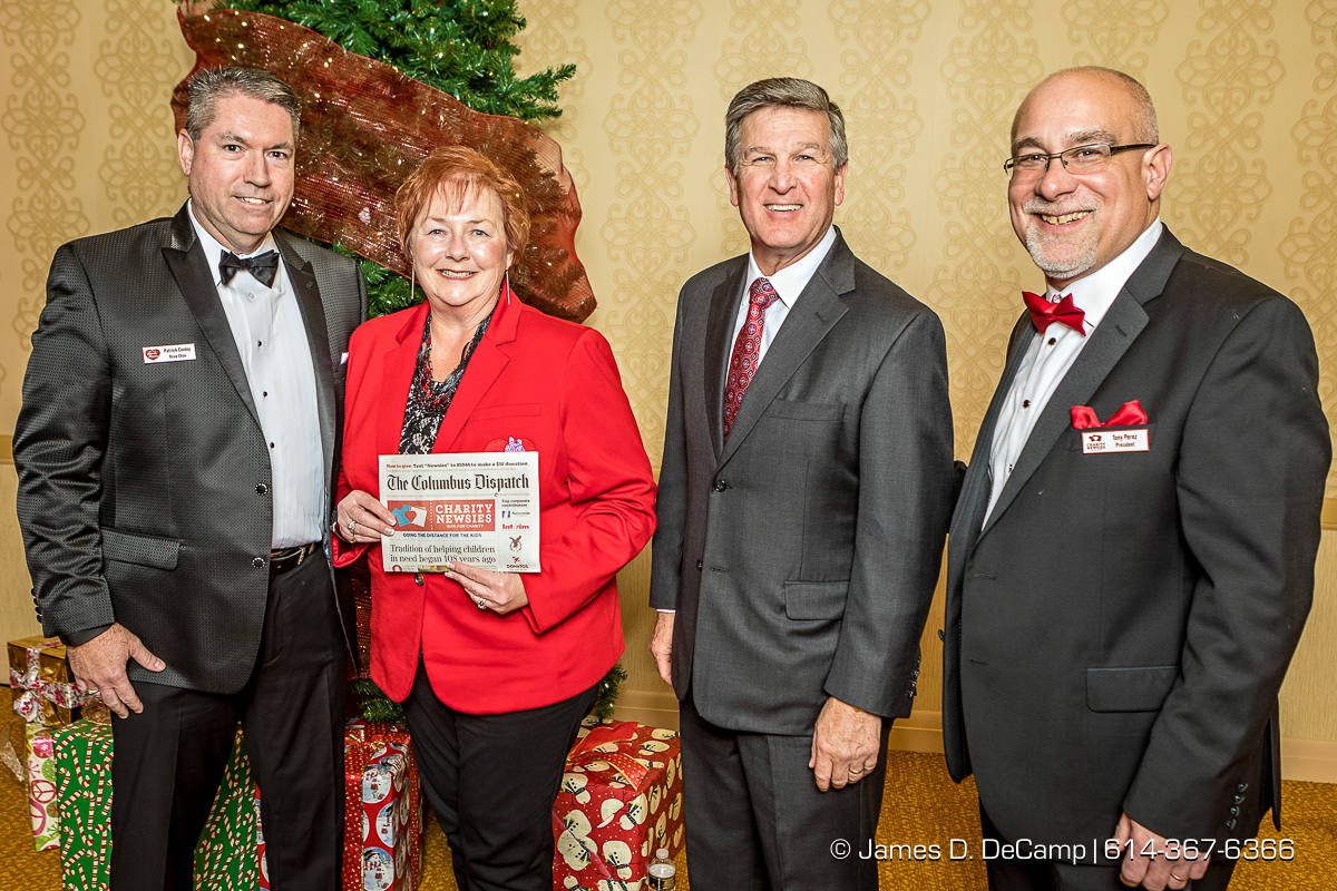 The third newspaper in the The 2017 Clothe-a-Child Gala and 110th annual Charity Newsies Newspaper Auction was sold to CompManagement: (l-r) Pat Conley, Kathy Redmond, Randy Jones and Tony Perez photographed Thursday, November 30, 2017 at the Hollywood Casino Ballroom. (© James D. DeCamp | http://JamesDeCamp.com | 614-367-6366)