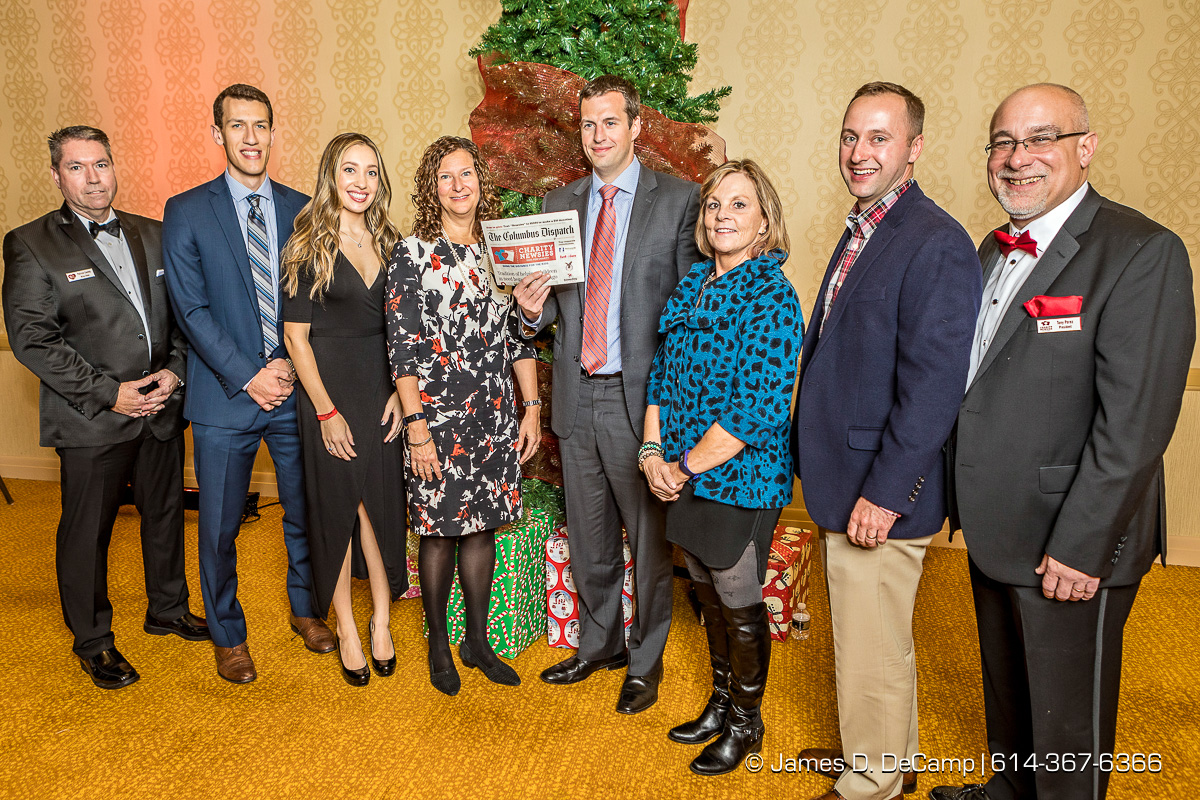 The third newspaper in the The 2017 Clothe-a-Child Gala and 110th annual Charity Newsies Newspaper Auction was sold to the Galvin Foundation: (l-r) Pat Conley, Michael Timm, Sarah Craycraft, Michelle Strohe, Dan Barnett, Joyce Waters, Dan Gusty and Tony Perez photographed Thursday, November 30, 2017 at the Hollywood Casino Ballroom. (© James D. DeCamp | http://JamesDeCamp.com | 614-367-6366)