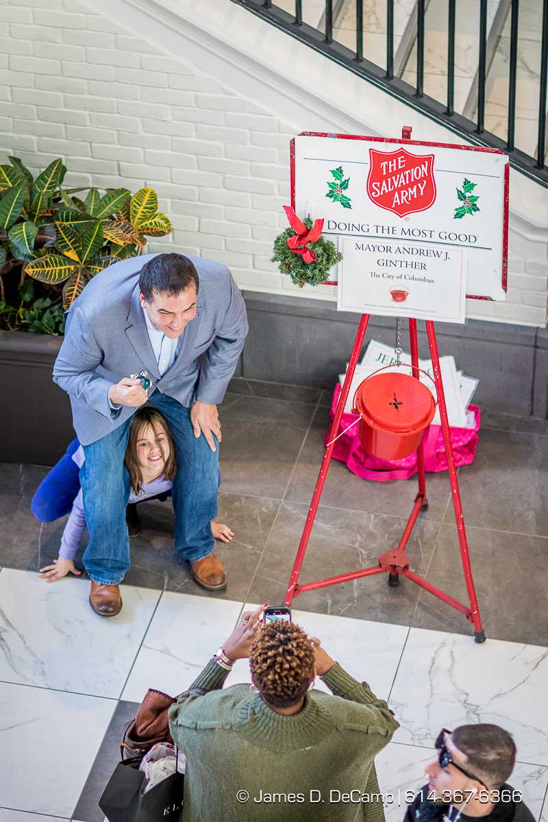 Columbus Mayor Andrew Ginther manning the Salvation Army station at the Easton Town Center photographed Saturday, December 16, 2017. (© James D. DeCamp | http://JamesDeCamp.com | 614-367-6366)