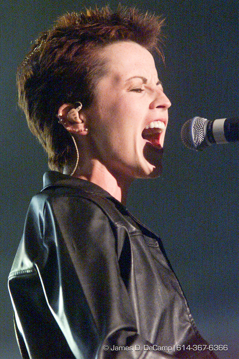Dolores Mary Eileen O'Riordan belts out a song at Polaris Amphitheater Tuesday night as the Cranberries played to a large crowd. (© James D. DeCamp | http://www.JamesDeCamp.com | 614-367-6366) [Photographed with Canon EOS D2000 cameras in RAW mode with L series lenses.]