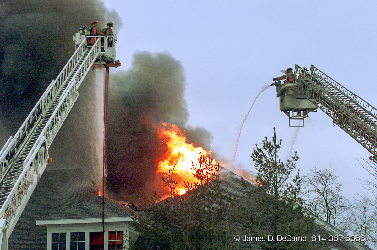 Firefighters from more than 7 different departments battle a blaze at the Jefferson Golf Course Club House Friday February 11, 2000. The fire which started in an out building about 100 yards from the clubhouse, apparently jumped from one building to the other and caused a general alarm (3+) on the East side. No one was reported injured. (© James D. DeCamp | http://www.JamesDeCamp.com | 614-367-6366) [Photographed with Canon EOS D2000 cameras in RAW mode with L series lenses.]